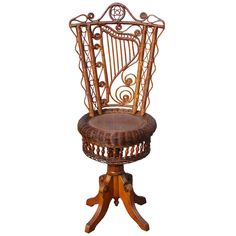 1880 Victorian Wicker Piano Stool - revolving stool in original natural stained finish. Harp motif woven into the backrest amid curlicues, reed loops, and scalloping. Seat spins to raise or lower height. Diminutive size indicates use by a youthful musician to play the piano or pianoforte.