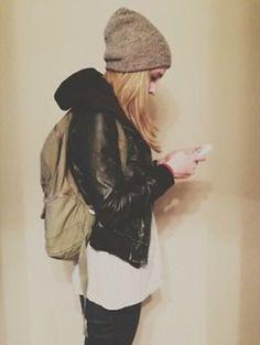 Black motorcycle type jacket with hoodie. Slouchy beanie. Backpack.