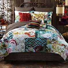 The quirky Michaila reversible quilt brings bohemian flair into your bedroom with an exciting collage of pattern and color. A patchwork of distressed floral prints pairs with modern geometric prints for a richly textured and colorful piece of bedding art.