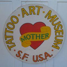 LYLE TUTTLE.COM tat art museum logo