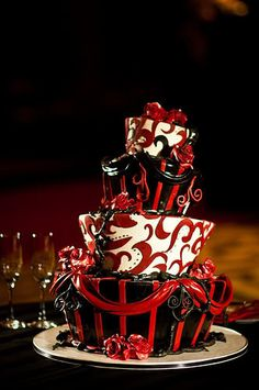 Man had I seen this early on - this would have been PERFECT for our venue.  beautiful red & black wedding cake