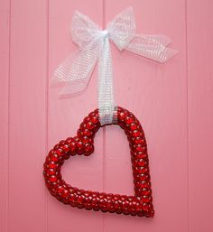 Valentine Wreath  Red cellophane wrapped Styrofoam heart, with red glass vase fillers glued on