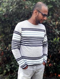 The Men's Breton T-shirt PDF sewing pattern is a straight T-shirt with long set-in sleeves. The boat neckline is folded under and stitched. A Breton T-shirt is characterized by a simple straight silhouette, slim body, and set-in sleeves. T Shirt Sewing Pattern, Mens Sewing Patterns, Sewing Magazines, Slim Body, Sport Casual, Casual Tops, Classic T Shirts, Men Sweater, Long Sleeve