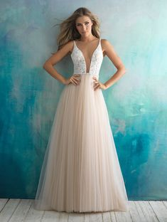 Allure Bridals beaded wedding dress with illusion neckline and blush tulle skirt #blushweddingdress #illusionneckline #weddingdress #beadedweddingdress