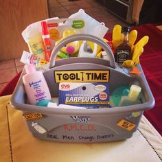 """Mens Baby Shower ~ RMCD - Real Men Change Diapers A """"Daddy Toolbox"""" to give to Daddy's-To-Be   Contents: diaper, butt paste, baby shower gel, baby lotion, diaper disposable baggies with carrier, baby powder, rattle, pacifiers, face mask, rubber gloves, ti"""