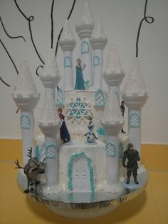 Frozen castle cake I used the Wilton castle cake kit, white and blue rock candy, blue and white sugar sprinkles. For the snowflake, I printed out a picture of the snowflake put wax paper on top and used melted candy melts to trace the lines and fill in the spaces.