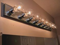 Is a dated bathroom light fixture making you look bad? See how easy it is to install new lighting over your bathroom mirror.
