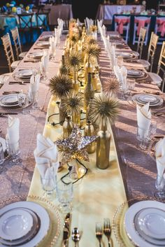 Gorgeous Gold King's Table at  Happy Days for A Nuptial Soiree Hosted by Totally Cooked Catering. Backdrop and linens by Sitting Pretty Linens.  Tableware from Miller's Party Rental. Lighting Design by Something New Entertainment. Photo: Nick Edmundson www.nickedmundsonimaging.com
