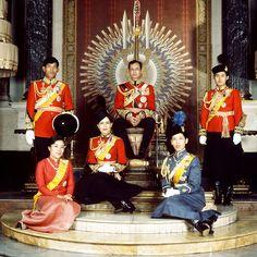 1979: King Bhumibol Adulyadej is seated on the throne in Chakri Hall of the Grand Palace, Bangkok, w/ Queen Sirikit, Crown Prince Maha Vajiralongkorn, Princess Ubolratana Rajakanya, Princess Maha Chakri Sirindhorn & Princess Chulabhorn Walailak