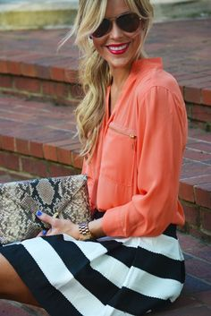 love the orange with the contrasted shades of black and white with a animal print clutch #stylingchaos