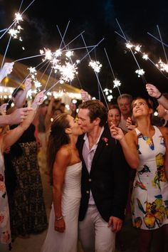 Gorgeous sparkler exit: http://www.stylemepretty.com/florida-weddings/florida-keys/islamorada/2016/02/01/casual-elegant-island-wedding-in-the-florida-keys/ | Photography: Kallima Photography - http://kallimaphotography.com/