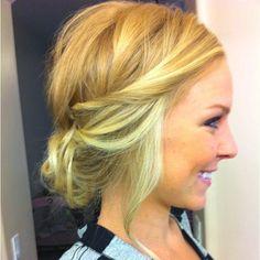Messy blonde hair, loose tuck updo