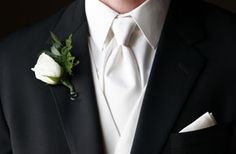 So elegant with white shirt, west and tie.