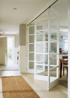 Like the idea of a folding door room divider b/w living and dining, but would do solid below, glass above. Nice to open it up to add tables for a large family meal like Thxgiving.