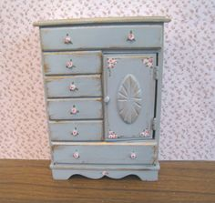 French, shabby chic chest of  drawers, duck egg blue,  distressed white with rose bouquets,  Twelfth scale dollhouse miniature. $18.50, via Etsy.