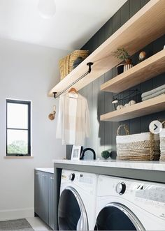 Honey Stained Floating Shelves on Black Shiplap Wall - Transitional - Laundry Room Honey Stained Floating Shelves on Black Shiplap Wall - Transitional - Laundry Room Mudroom Laundry Room, Laundry Room Layouts, Laundry Room Shelves, Laundry Room Remodel, Farmhouse Laundry Room, Laundry Cabinets, Farmhouse Sinks, Oak Floating Shelves, Floating Floor