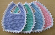 Baby bibs made by Tangles. Crochet Baby Bibs, Crochet Baby Sandals, Baby Blanket Crochet, Crochet For Kids, Crochet Yarn, Easy Crochet, Crochet Clothes, Baby Knitting, Crotchet Patterns