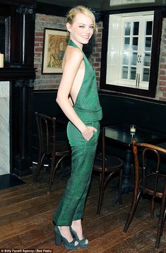 New York Fashion Week 2012: Emma Stone looks like a supermodel as she shows off pencil-thin frame in backless emerald jumpsuit | Mail Online