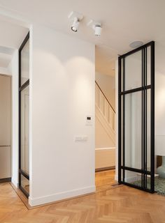 Steel door frames. Private home Amsterdam: interior design and project management by Heyligers design+projects. www.h-dp.nl
