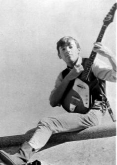 Bruce Springsteen posing with his guitar in 1965 at the Castiles' first promo shoot.