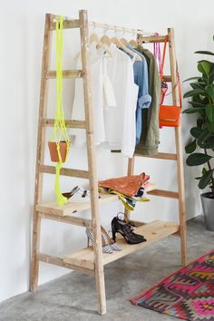 "DIY ladder clothing rack  Perfect for clothes that are ""in use"" during the week, and most frequently used shoes.  I'd had some pegs/hooks/door knobs on the sides for stuff that doesn't need a hanger."