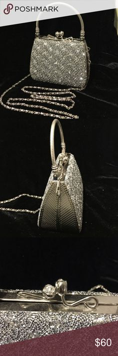 """Silver Tone EVENING Bag. Purchased last year for formal New Years party!  In perfect condition. Solid Satchel handle, addition option of chain strap for cross body or shoulder.  Black background, covered with silver sequins, on bother sides. Rose bud secure snap closure at top. Interior black lined with center zipper compartment for valuables.  Measures 5"""" wide x 4"""" high. Bags Satchels"""