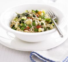 pea and zucchini risotto with basil. Would be perfectly garnished with shaved parm.Tomato, pea and zucchini risotto with basil. Would be perfectly garnished with shaved parm. Bbc Good Food Recipes, Veggie Recipes, Asian Recipes, Vegetarian Recipes, Cooking Recipes, Healthy Recipes, Ethnic Recipes, Vegetarian Dish, Veggie Meals