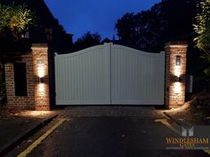 Accoya Wood Swing Gate How beautiful does this new installation in Camberley, Surrey look all lit up at night. Flemish bond brickwork to match the house with built in parcel box and slate name sign. Front Gate Design, House Gate Design, Fence Design, Timber Gates, Wooden Gates, Front Gates, Entrance Gates, Wooden Electric Gates, Gate Lights