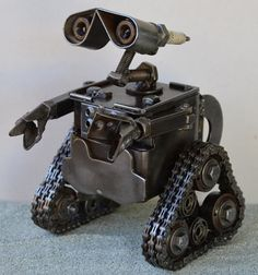 This Wall-E sculpture is entirely hand made from recycled scrap metal and car parts. The sculpture is approximately 4 inches tall and a fantastic collectors piece! The artists use car parts, motorcycle parts, nuts and bolts, Scrap Metal Art Welding Art Projects, Metal Art Projects, Metal Crafts, Welding Crafts, Diy Projects, Metal Sculpture Artists, Steel Sculpture, Art Sculptures, Sculpture Ideas