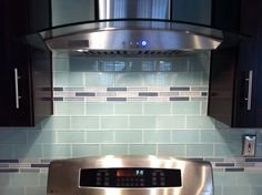 Glass Subway TIle Backsplash With Glass Mosaic Inlay