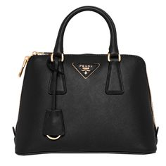 Classic and timeless, this stunning Prada handbag is constructed from rich, Saffiano leather. This black handbag features goldtone hardware, double rolled handles, and the signature triangle logo.