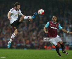 Juan Mata of Manchester United in action with Dimitri Payet of West Ham United during the Barclays Premier League match between West Ham United and Manchester United at the Boleyn Ground on May 10, 2016 in London, England.