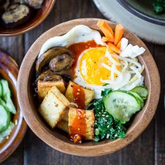 Pan-fried tofu is my protein of choice for Korean Bibimbap Bowls. Topped with seasonedvegetables, a dippy fried egg, and flavorfulgochujang...
