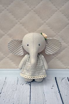 elephant pdf pattern, PDF Plush elephant, stuffed elephant, Soft Animal, Animal toy, сloth toyPattern and tutorial for sewing of the elephant I want to present master class of a toy elephant This master class is aimed for people, who have already sewn toys. Difficulty: medium The pattern is on A4 sheet of paper, elephants hight is approximately 20-22 cm (9). You will need a single colored cotton fabric for the body and the multi colored fabric for a dress This master class includes pat...
