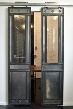 Antique elevator doors repurposed as sliding doors. We have elevator gates and hundreds of doors to make something similar to this! Old Doors, Windows And Doors, Sliding Doors, Entry Doors, Antique Doors, Front Doors, Patio Doors, Entrance, Interior Barn Doors