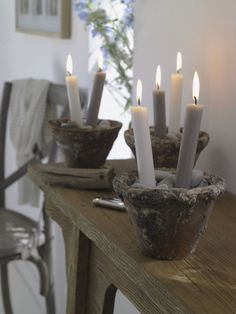 Super elegant and easy... You could do sand or glass beads in the pots as well!