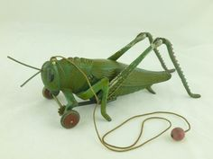 HUBLEY CAST IRON PULL TOY GRASSHOPPER CIRCA 1920's-1930's