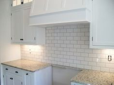 Tile Backsplash With White Cabinets cream colored cabinets, white subway tile backsplash, island