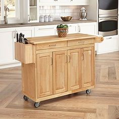 Home Styles 5023-95 Wood Top Kitchen Cart with Breakfast Bar, Natural Finish Home Styles http://www.amazon.com/dp/B00009N86T/ref=cm_sw_r_pi_dp_3e16wb01A6W3S