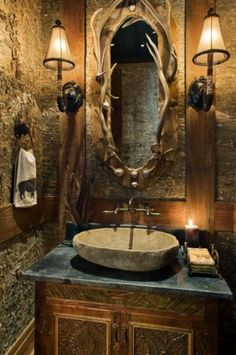 I love this rustic bathroom. I'd not have the antlers, but probably some detailed, carved wood around the mirror. Love the lighting, the colors, and the sink!