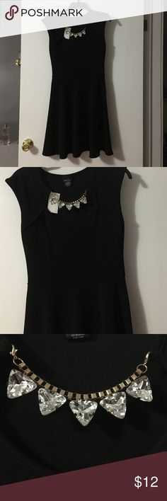 Final dress NWT. Fits like a skater dress. Tight at the top and loose at the bottom. Has a jewel necklace made in to the dress at the neckline. Rue 21 Dresses