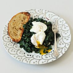 Spicy Garlic Kale With Poached Eggs: Throw this simple but satisfying meal of spicy garlic kale and poached eggs together, and your wallet will thank you! Photo: Nicole Perry