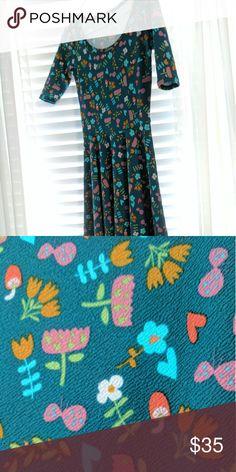 Lularoe XS Nicole Dress 96% Polyester, 4% Spandex - XS Nicole, washed once per LLR instructions, never worn. LuLaRoe Dresses