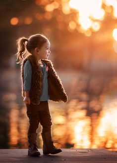 Little girl in autumn light. Beautiful rim light at sunset