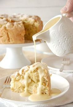 Irish Apple Cake with Custard Sauce Recipe ~ The cake is excellent all on it's own, but what really turns it into a decadent dessert is the custard sauce. Poured warm over the top of a slice of apple cake, its creamy sweetness is the perfect addition to the thick fruit filled cake