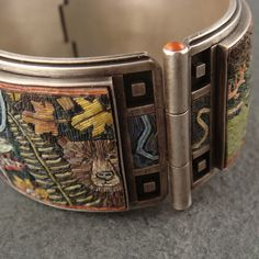 Looking at the detail ~ Bracelet | Chuck Domitrovich (the Sterling silver work and Carnelian edges) and Cynthia Toops (the Polymer mosaic).