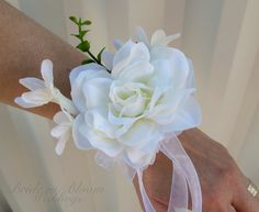 corsage for mother of the bride, mother of the groom, and grandmothers. (minus the ribbon hanging down)