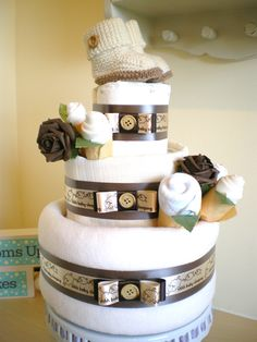 Three tier neutral nappy cake with knitted Bugg boots.