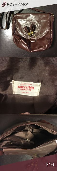 🛍Mossimo cognac brown crossbody purse Mossimo cognac brown crossbody purse- this is the perfect size purse for running about town! Has a flap with tassel and imprint design on the front, has two pockets and a zippered pocket inside and adjustable strap to get your desired length! Mossimo Supply Co Bags Crossbody Bags