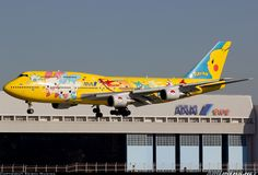 "All Nippon Airways - ANA Boeing 747-481D JA8957 ""Pokemon Pikachu"" over the numbers at Tokyo-Haneda, November 2012. (Photo: Keishi Nukina)"